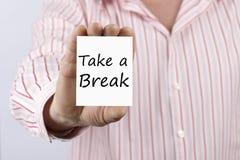 Tome uma ruptura escrita no cartão imagem de stock royalty free