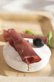 Tomino cheese and bresaola Stock Photos