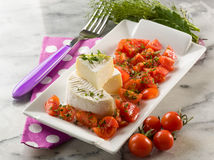Tomino cheese with pachino tomatoes Royalty Free Stock Photos