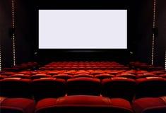 Tomma bioplatser med den tomma vita skärmen Fotografering för Bildbyråer