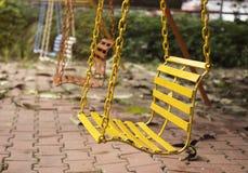 Tomma chain gungor i lekplats med tappning filtrerar Fotografering för Bildbyråer