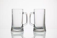 Tomma exponeringsglas av öl Arkivfoton