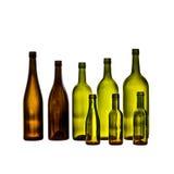 Tomma glass vinflaskor på vit bakgrund Arkivbilder