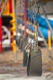 tomma lekplatsswings Royaltyfri Foto