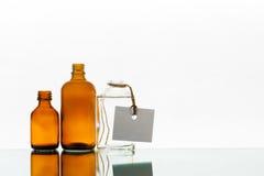 Tomma medicinflaskor på den ljusa bakgrunden Fotografering för Bildbyråer
