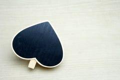 Tomma svarta svarta tavlor för hjärta i wood ramar Arkivfoton