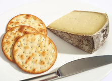 Tomme de Savoie cheese and biscuits Stock Photography