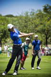Tommy Fleetwood. Clubbing the ball up the fairway, heading to the green, on the 4th day of the tournament Stock Photos