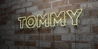 TOMMY - Glowing Neon Sign on stonework wall - 3D rendered royalty free stock illustration Royalty Free Stock Image
