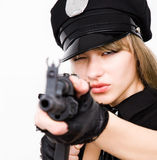 Tommy gun. Portrait of young woman aim with black tommy gun royalty free stock photo