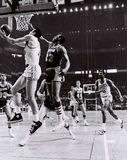 Tommy Heinsohn and Bill Russell Celtics Greats. Former Boston Celtics superstars Tommy Heinsohn (15) and Bill Russell (6) take on the LA Lakers. (Image from B&W Royalty Free Stock Image