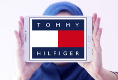966750046 Tommy hilfiger logo. Logo of fashion company, tommy hilfiger on samsung  tablet holded by