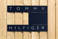 Tommy Hilfiger logo on a wall. Villefranche, France - June 11, 2017: Tommy Hilfiger logo on a wall. Tommy Hilfiger is an American multinational that designs and Stock Images