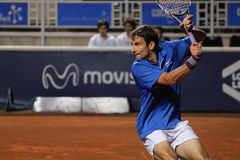 Tommy Robredo. SANTIAGO, CHILE - FEB 2 2010: Tommy Robredo using his forehand against Ricardo Mello during the ATP of Santiago, Chile. February 2, 2010 in Stock Photos