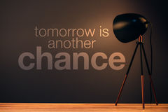 Tomorrow is another chance motivational quote. On office wall illuminated by the desk lamp royalty free stock images