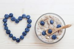 Tomorrow is blueberries and oat flakes. The symbol of the heart is laid out of blueberries Stock Photography