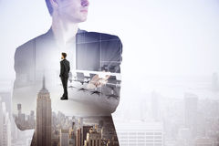 Tomorrow concept. Abstract image of thoughtful businessman thinking about work on creative city background with copy space. Tomorrow concept. Double exposure royalty free stock image