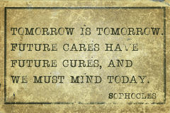 Tomorrow Sophocles. Tomorrow is tomorrow - ancient Greek philosopher Sophocles quote printed on grunge vintage cardboard Royalty Free Stock Image