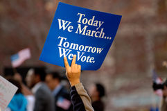 Tomorrow we vote. Hand holding political sign at rally Stock Images