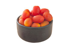 Tomoto fruit in a black bowl isolated, Clipping path Royalty Free Stock Photos