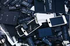 Mobile phone batteries, tablets, broken screens LCD iPhone royalty free stock photos
