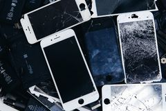 Mobile phone batteries, tablets, broken screens LCD iPhone royalty free stock images