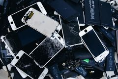 Mobile phone batteries, tablets, broken screens LCD iPhone stock images