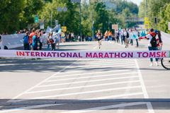 Tomsk, Russia - June 9, 2019: International Marathon Jarche athletes runners crowd are at finish stock image