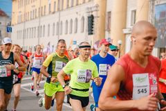 Tomsk, Russia - June 9, 2019: International Marathon Jarche athletes runners crowd are at start royalty free stock photo