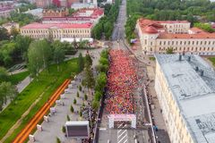 Tomsk, Russia - June 9, 2019: International Marathon Jarche athletes runners crowd are at start. Aerial top view stock image