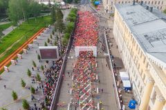 Tomsk, Russia - June 9, 2019: International Marathon Jarche athletes runners crowd are at start. Aerial top view royalty free stock photo
