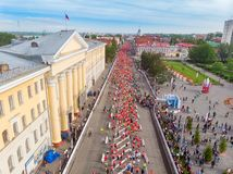 Tomsk, Russia - June 9, 2019: International Marathon Jarche athletes runners crowd are at start. Aerial top view stock photos