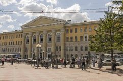 Tomsk, Russia,The Tomsk University of Control Systems and Radioelectronics in summer day. July 10, 2017. Lot of peoples around. Bi. G fountain Royalty Free Stock Photo