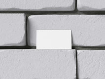 Tomt affärskort på brickwallen framförande 3d Arkivfoton