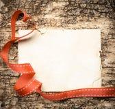 Tomt anteckningsbokpapper med hjärtabandet Royaltyfri Foto