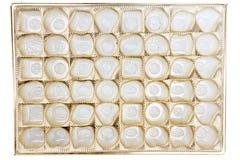 Tomt boxas av choklader Arkivbild