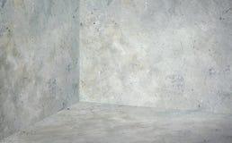 Tomt hörnrum med grå betongvägg- och golvbakgrund, M arkivbilder