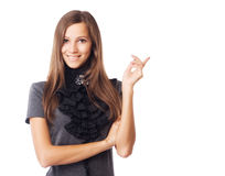 Tomt område för lycklig ung elegant kvinnavisning för copyspase royaltyfri foto