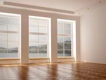 Ett rymligt rum med tre stora fönster Royaltyfria Foton
