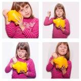 Tonårig flicka med gul monebox royaltyfria foton