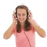 Tonårig flicka med head telefoner Arkivfoton