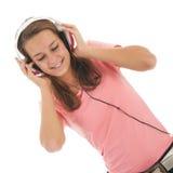 Tonårig flicka med head telefoner Royaltyfria Foton