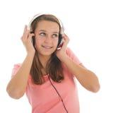 Tonårig flicka med head telefoner Royaltyfri Bild
