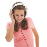 Tonårig flicka med head telefoner Arkivbild
