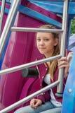 Tonårig flicka på karusellen Royaltyfri Foto