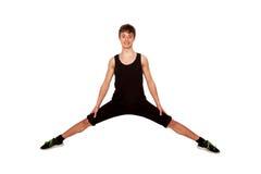 Tonårig pojke som gör övningen som spelar sportar Arkivfoton
