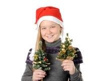 Tonårigt i jultomtenhatt Fotografering för Bildbyråer
