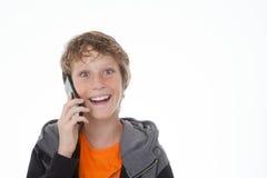 Tonårigt på cellen eller mobiltelefonen Royaltyfria Foton