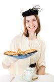 Tonårigt på tebjudningen med kakor Fotografering för Bildbyråer