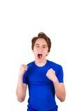 Tonåring i den blåa T-tröja som isoleras på vit bakgrund Arkivfoto